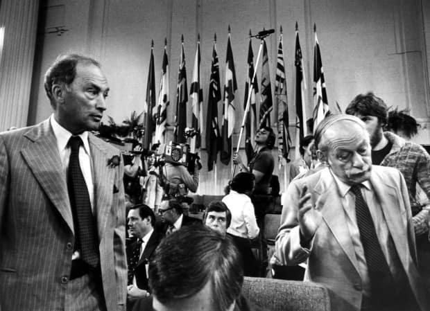 Quebec Premier Rene Levesque (R) shrugs his shoulders and walks away from Prime Minister Pierre Trudeau (L) after a chat prior to the beginning of the second day of the Constitution Conference on Sept 9, 1980.