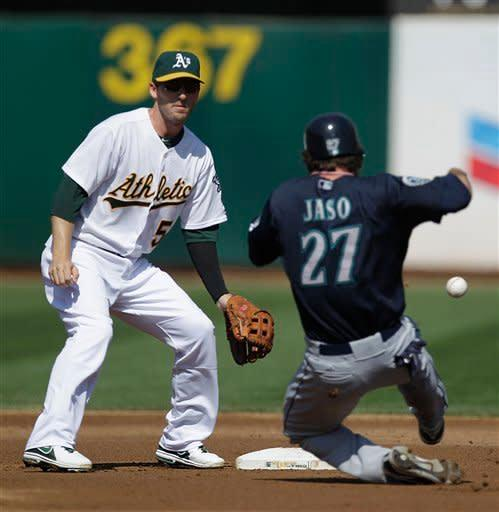 Seattle Mariners' John Jaso (27) steals past Oakland Athletics shortstop Stephen Drew, left, in the second inning of a baseball game Saturday, Sept. 29, 2012, in Oakland, Calif. (AP Photo/Ben Margot)