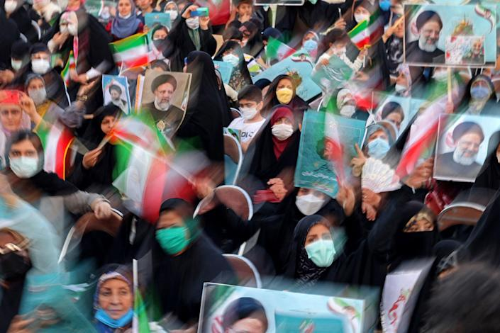 Image: Supporters of Iranian presidential candidate Ebrahim Raisi attend an election campaign rally in Tehran, Iran, on June 14, 2021. (Atta Kenare / AFP - Getty Images file)