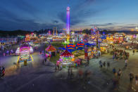 FILE - In this Aug. 9, 2018, file photo, fair-goers attend The State Fair of West Virginia at the State Fairgrounds in Fairlea, W.Va. West Virginia has seen a higher percentage of residents depart than any other state in the past decade. (Craig Hudson/Charleston Gazette-Mail via AP, File)