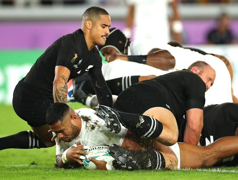 YOKOHAMA, JAPAN - OCTOBER 26: Manu Tuilangi of England crosses for the first try during the Rugby World Cup 2019 Semi-Final match between England and New Zealand at International Stadium Yokohama on October 26, 2019 in Yokohama, Kanagawa, Japan. (Photo by Cameron Spencer/Getty Images)