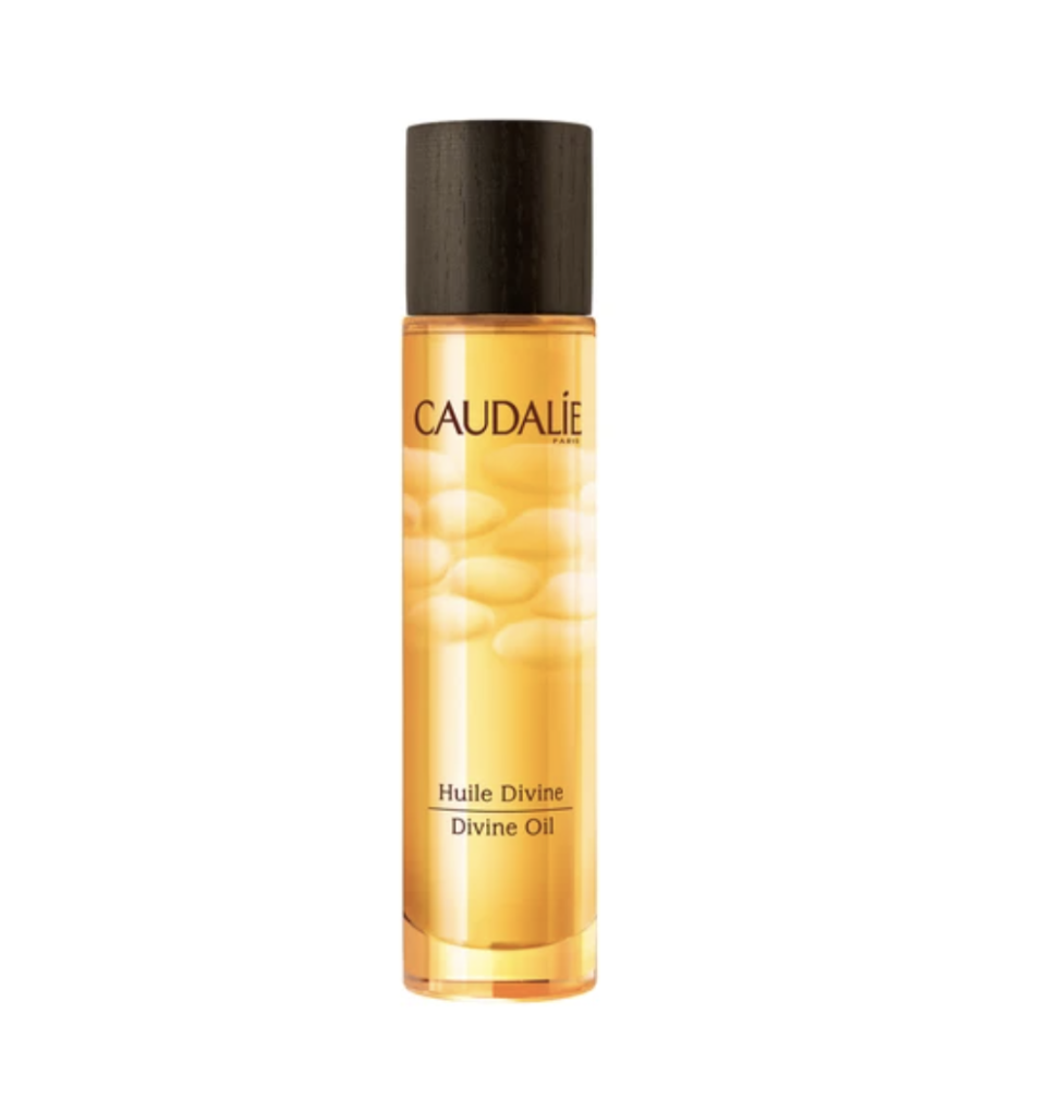 """<p><strong>Caudalie</strong></p><p>amazon.com</p><p><strong>$49.00</strong></p><p><a href=""""https://www.amazon.com/dp/B0083S3MYC?tag=syn-yahoo-20&ascsubtag=%5Bartid%7C10055.g.33012147%5Bsrc%7Cyahoo-us"""" rel=""""nofollow noopener"""" target=""""_blank"""" data-ylk=""""slk:Shop Now"""" class=""""link rapid-noclick-resp"""">Shop Now</a></p><p>This rich, decadent Caudalie body oil spray is loaded with intensely nourishing botanical oils, including grape seed, sesame, sunflower, hibiscus, and argan. """"I love that you can <strong>quickly spritz this on and it immediately relieves <a href=""""https://www.goodhousekeeping.com/beauty/anti-aging/a29993947/dry-skin-on-face-treatments-causes/"""" rel=""""nofollow noopener"""" target=""""_blank"""" data-ylk=""""slk:dehydrated skin"""" class=""""link rapid-noclick-resp"""">dehydrated skin</a></strong>, especially on the legs,"""" GH's beauty director says. """"I can't get enough of the warm, creamy light musk scent and the multi-purpose formula can be used on hair or face and as a <a href=""""https://www.goodhousekeeping.com/beauty-products/g28566896/bubble-bath-products/"""" rel=""""nofollow noopener"""" target=""""_blank"""" data-ylk=""""slk:bath oil"""" class=""""link rapid-noclick-resp"""">bath oil</a>, too.""""</p>"""