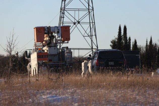 OPP and Hydro One trucks stand near a Hydro One crash near Tweed, Ont., on Dec. 14, 2017.
