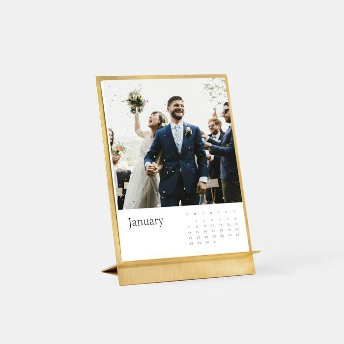<p>Turn all of those photos you've texted them throughout the year into a gorgeous calendar. Unlike unsightly wall calendars, the <span>Brass Easel & Calendar</span> ($49 and up) is absolutely gorgeous.</p>