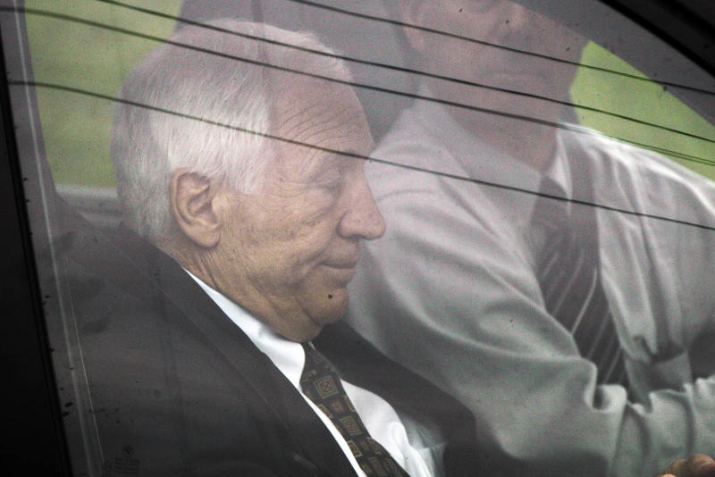 Former Penn State University assistant football coach Jerry Sandusky, left, arrives with his attorney Joe Amendola for the second day his trial at the Centre County Courthouse in Bellefonte, Pa., Tuesday, June 12, 2012. Sandusky faces 52 counts of child sex-abuse involving 10 boys over a 15-year span. (AP Photo/Gene J. Puskar)