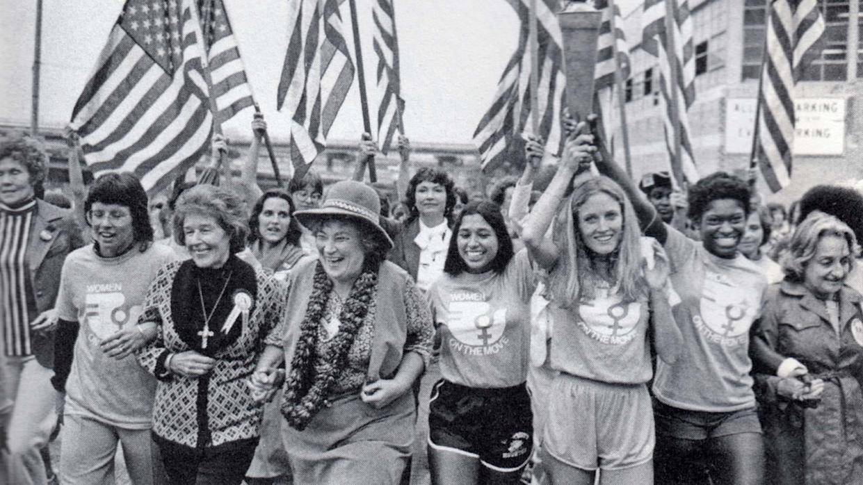 Marchers with the Olympic torch at the National Women's Conference, (left to right) Billy Jean King, Susan B. Anthony II, Bella Abzug, Sylvia Ortiz, Peggy Kokernot, Michele Cearcy, Betty Friedan, 1977. (Photo: Getty Images)