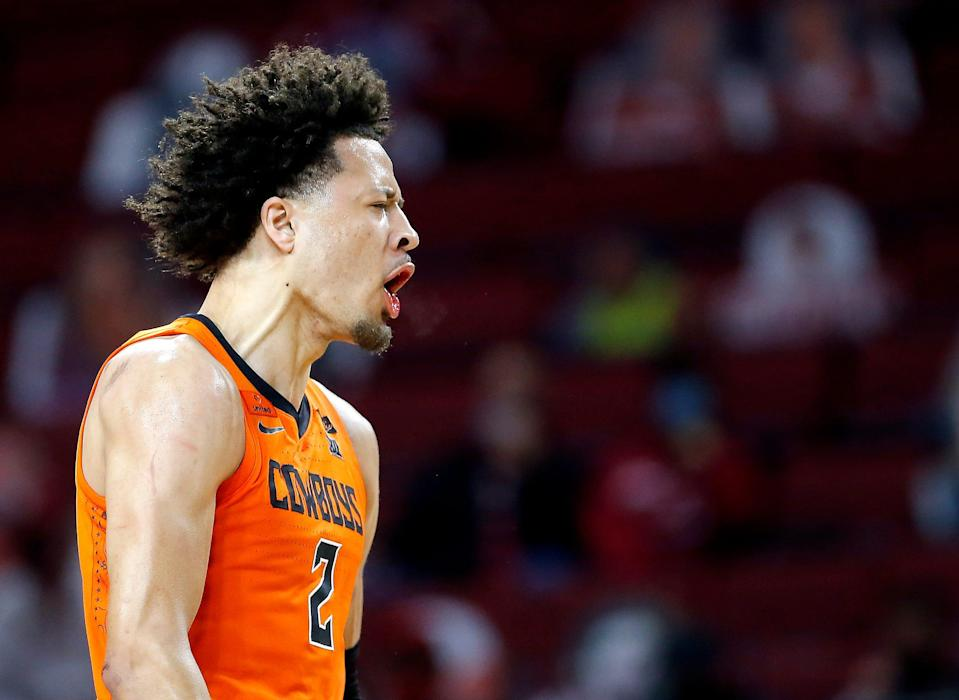 Oklahoma State's Cade Cunningham celebrates after a basket against Oklahoma during an overtime win Feb. 27, 2021 in Norman, Okla.