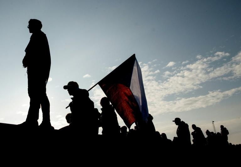 Some demonstrators waved flags or brandished banners calling for Babis to step down (AFP Photo/Michal Cizek)