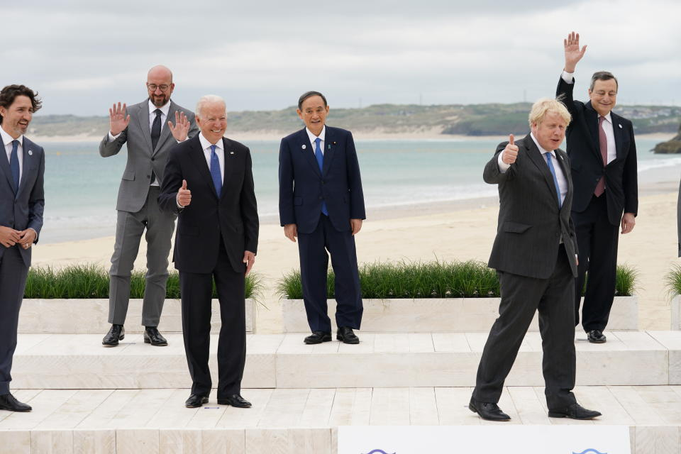 From left, Canadian Prime Minister Justin Trudeau, European Council President Charles Michel, U.S. President Joe Biden, Japan's Prime Minister Yoshihide Suga, British Prime Minister Boris Johnson and Italy's Prime Minister Mario Draghi pose for a family photo during the G7 summit in Carbis Bay, England, Friday,  June 11, 2021. (Kevin Lamarque/Pool via AP)