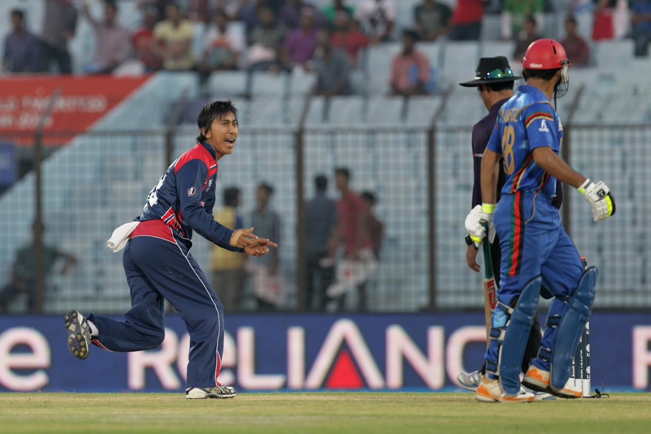 CHITTAGONG, BANGLADESH - MARCH 20: Shakti Gauchan of Nepal gives Nawroz Mangal of Afghanistan a send off after dismissing him during  the Afghanistan v Nepal match at the ICC World Twenty20 Bangladesh 2014 played at Zahur Ahmed Chowdhury Stadium on March 20, 2014 in Chittagong, Bangladesh. (Photo by Graham Crouch-IDI/IDI via Getty Images)