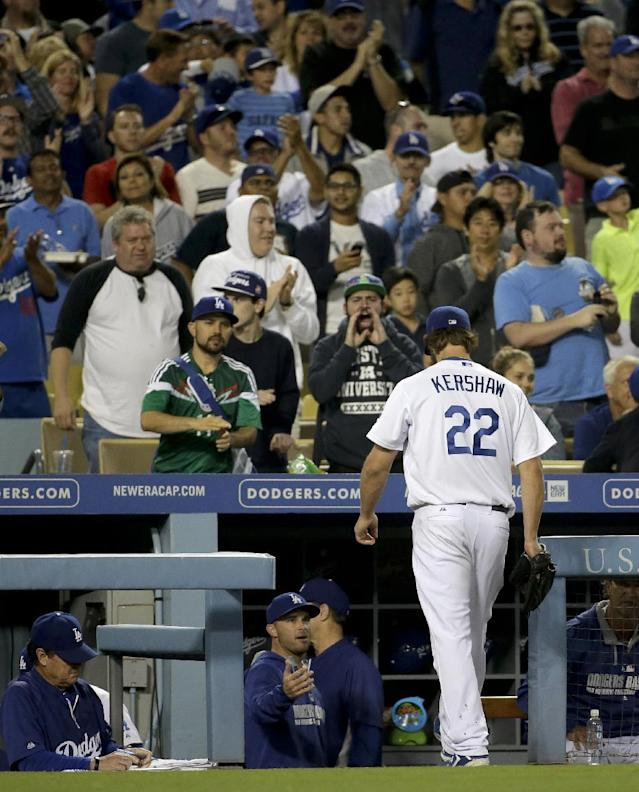 Los Angeles Dodgers starting pitcher Clayton Kershaw walks to the dugout after the end of the top of the seventh inning of a baseball game against the Colorado Rockies in Los Angeles, Wednesday, June 18, 2014. (AP Photo/Chris Carlson)