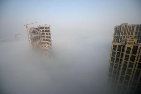 Heavy smog surrounds a construction site in Jinan