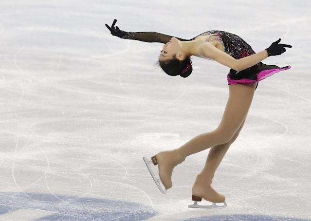 Li Zijun of China competes in the women's short program figure skating competition at the Iceberg Skating Palace during the 2014 Winter Olympics, Wednesday, Feb. 19, 2014, in Sochi, Russia. (AP Photo/Darron Cummings)