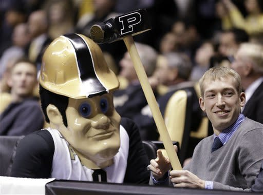 Former Purdue basketball player Robbie Hummel jokes with mascot Purdue Pete before he was honored at halftime of an NCAA college basketball game between Purdue and Michigan State in West Lafayette, Ind., Saturday, Feb. 9, 2013. Hummel is the 14th Purdue player to be honored with a banner in Mackey Arena. Hummel currently plays with Obradoiro CAB in Liga ACB in Spain.(AP Photo/Michael Conroy)