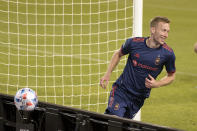 Chicago Fire forward Robert Beric (27) in celebrates his goal against the New England Revolution during the first half of an MLS soccer match in Chicago, Saturday, April 17, 2021. (AP Photo/Mark Black)