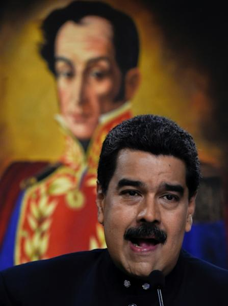 Venezuelan President Nicolas Maduro is accused by critics of clinging to power by hijacking state institutions amid shortages of food and medicine