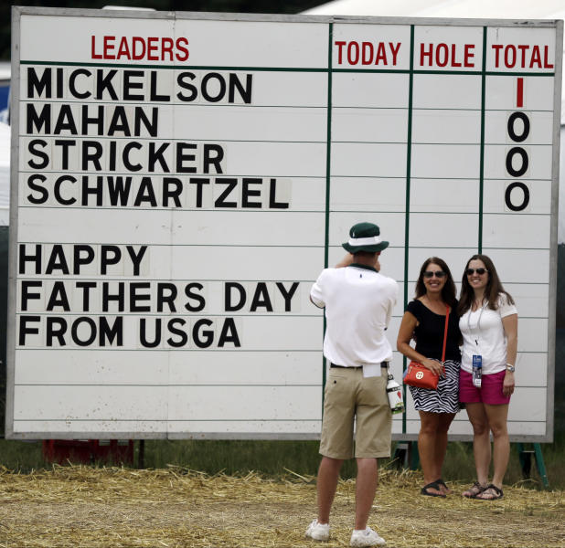 Spectators pose for a photo before the start of the fourth round of the U.S. Open golf tournament at Merion Golf Club, Sunday, June 16, 2013, in Ardmore, Pa. (AP Photo/Julio Cortez)
