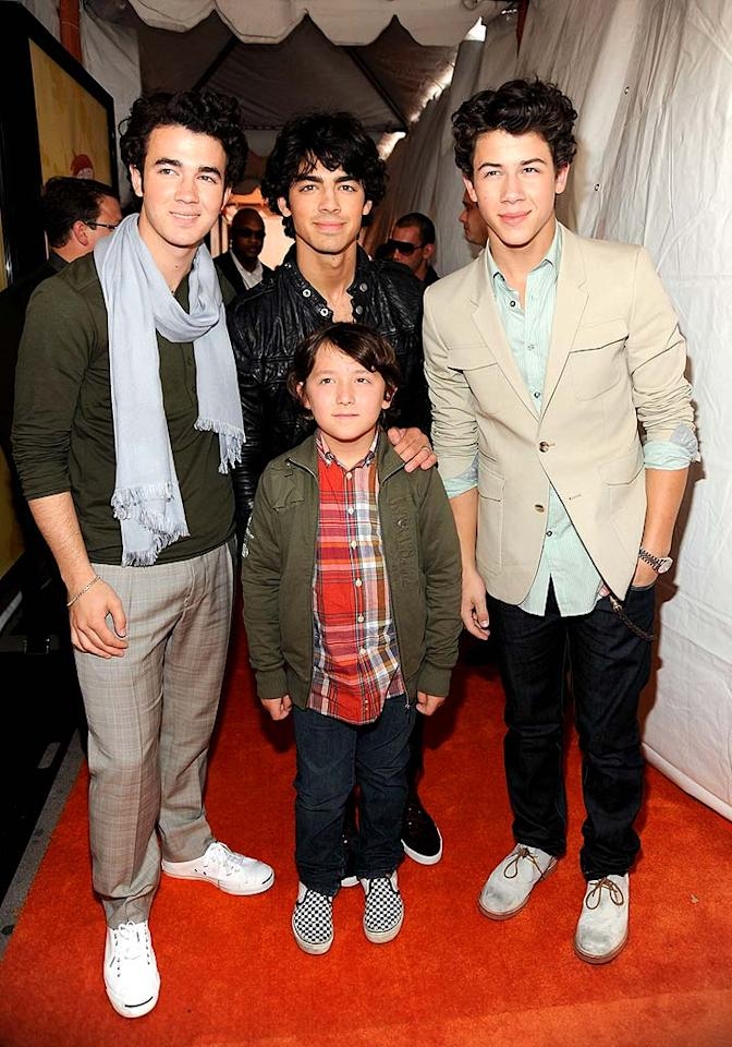 "The Jonas Brothers (Kevin, Joe, and Nick) brought their uniquely different styles to the orange carpet, as well as their youngest sibling, Frankie. Hopefully the adorable ""Bonus Jonas"" won't follow in his big bros' fashion footsteps when it comes to man scarves! Kevin Mazur/<a href=""http://www.wireimage.com"" target=""new"">WireImage.com</a> - March 28, 2009"
