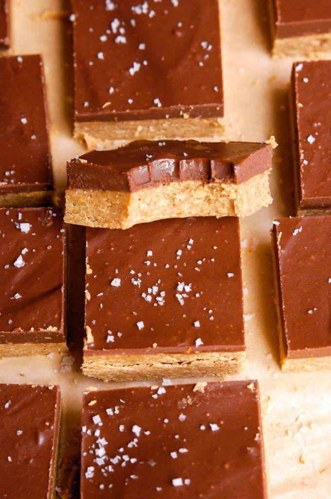 "<p>Make your tried-and-true Halloween candy more Thanksgiving appropriate by whipping up a batch of these layered chocolate peanut butter bars from scratch. (And if you really want to bring out their natural flavor, sprinkle with sea salt.)</p><p><em><a href=""https://www.erinliveswhole.com/no-bake-chocolate-peanut-butter-bars-vegan-gluten-free/"" rel=""nofollow noopener"" target=""_blank"" data-ylk=""slk:Get the recipe at Erin Lives Whole »"" class=""link rapid-noclick-resp"">Get the recipe at Erin Lives Whole »</a></em></p>"
