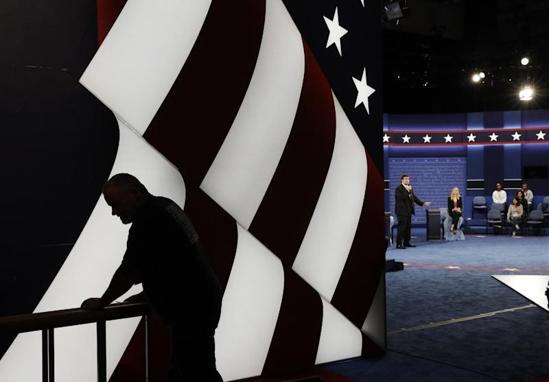 Students stand in on the stage as preparations are made for the second presidential debate between Republican presidential nominee Donald Trump Democratic presidential nominee Hillary Clinton at Washington University in St. Louis, Saturday, Oct. 8, 2016. (AP Photo/John Locher)
