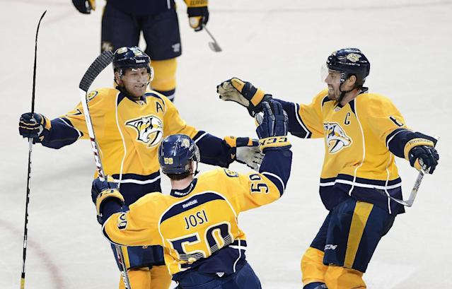Nashville Predators forward Patric Hornqvist left, of Sweden, and Shea Weber, right, celebrate with Roman Josi (59), of Switzerland, after Josi scored a goal against the Tampa Bay Lightning in the second period of an NHL hockey game, Thursday, Feb. 27, 2014, in Nashville, Tenn. (AP Photo/Mark Zaleski)