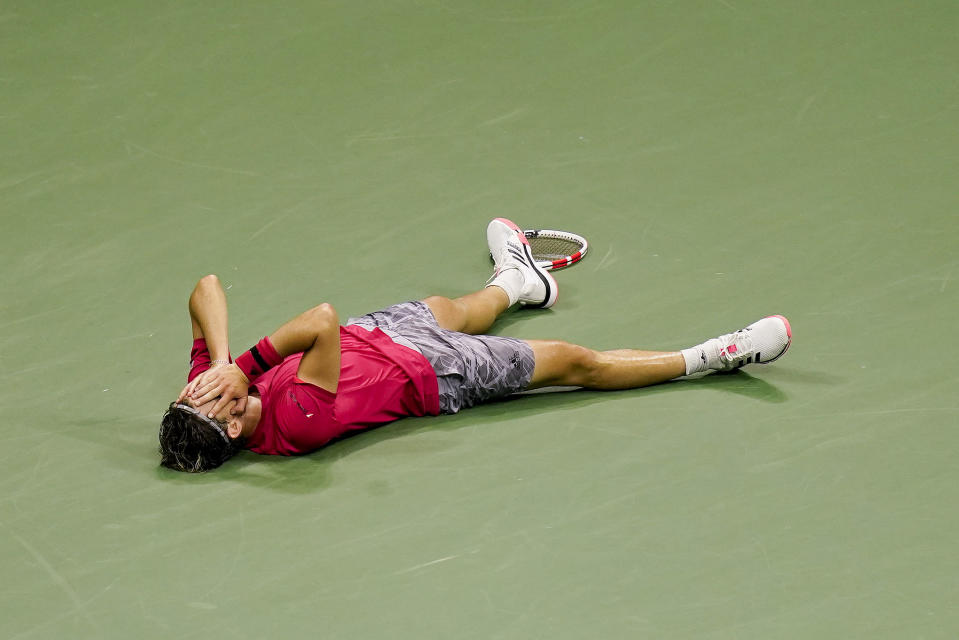 Dominic Thiem, of Austria, reacts after defeating Alexander Zverev, of Germany, in the men's singles final of the US Open tennis championships, Sunday, Sept. 13, 2020, in New York. (AP Photo/Seth Wenig)