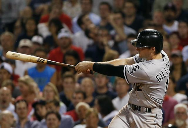 Chicago White Sox's Conor Gillaspie hits a two-run homer in the sixth inning of a baseball game against the Boston Red Sox at Fenway Park in Boston, Tuesday, July 8, 2014. (AP Photo/Elise Amendola)