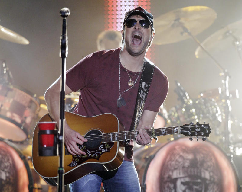 FILE - This June 6, 2012 file photo shows Eric Church performing on an outdoor stage during the CMT Music Awards show in Nashville, Tenn. Church is the lead nominee at Thursday's Country Music Association Awards in Nashville.  (AP Photo/Mark Humphrey, file)