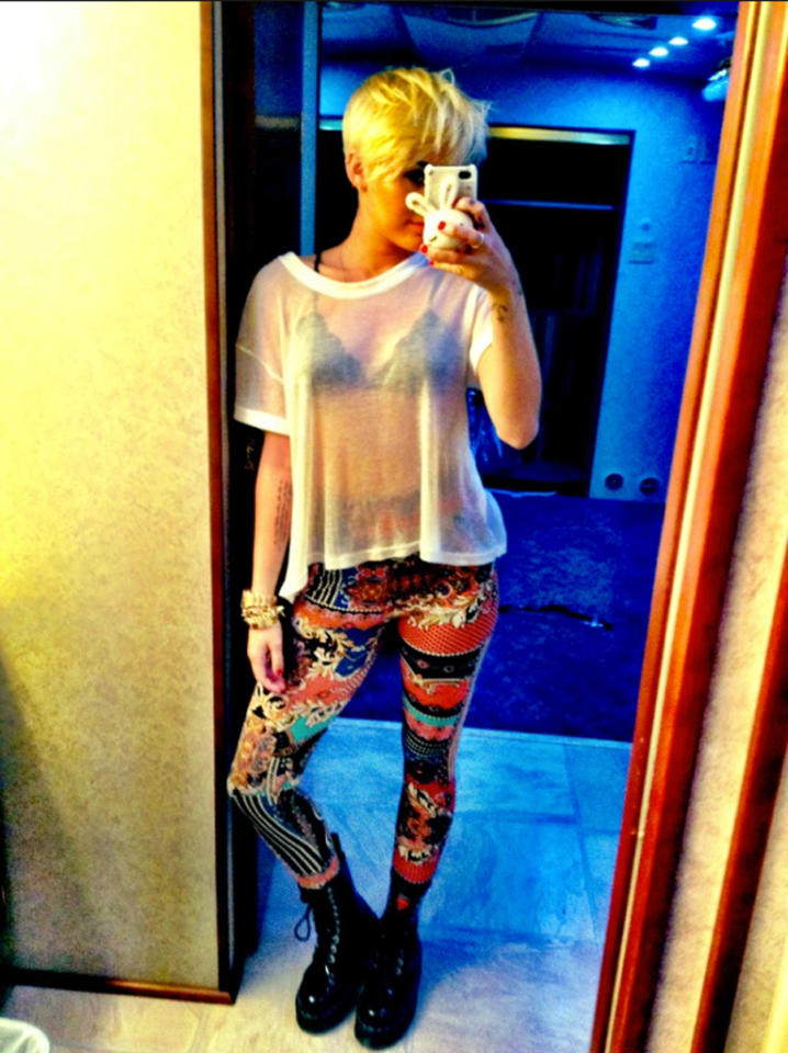 """<p class=""""MsoNoSpacing"""">Miley Cyrus quit Twitter in October 2009 because she said her then-boyfriend, now-fiancé Liam Hemsworth didn't like it. Two years later, she signed back on … and since then, has been oversharing more than ever. After months of posting photos of her super-skinny body (thanks to all that Pilates) and her collection of dogs, the former """"Hannah Montana"""" star has found a new muse: her bleached, half-shaved pixie cut, which she documented while in stylist Chris McMillan's chair – and has been tweeting about ever since! In this pic from August 15, Miley uploaded a photo of herself looking in a mirror, showing off her """"CUHHH-RAZY"""" pants – but, unfortunately, all we can focus on is her see-through shirt and black bra. </p>"""