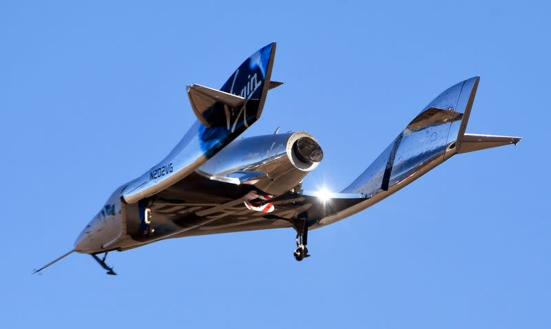 FILE PHOTO: Virgin Galactic's space tourism rocket plane SpaceShipTwo returns after a test flight from Mojave Air and Space Port in Mojave