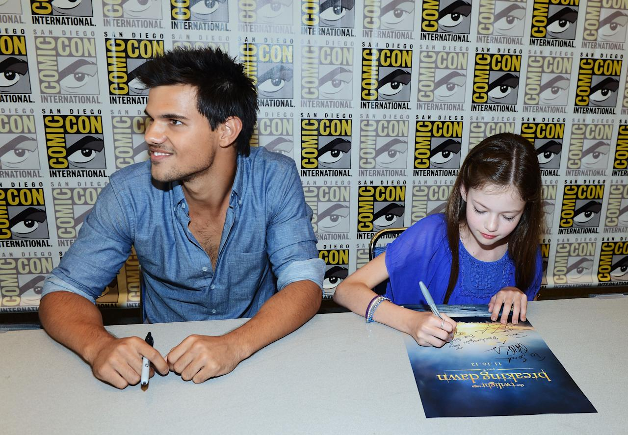 """SAN DIEGO, CA - JULY 12:  Actors Taylor Lautner (L) and Mackenzie Foy attend """"The Twilight Saga: Breaking Dawn Part 2"""" during Comic-Con International 2012 at San Diego Convention Center on July 12, 2012 in San Diego, California.  (Photo by Michael Buckner/Getty Images for Lionsgate)"""