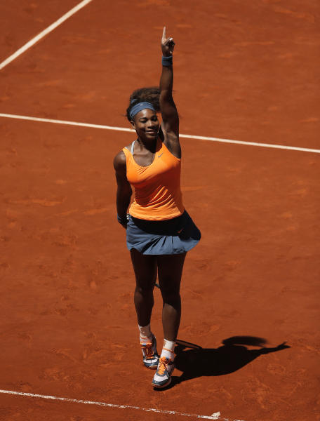 Serena Williams from U.S. celebrates her victory during the women's final match against Maria Sharapova from Russia at the Madrid Open tennis tournament, in Madrid, Sunday, May 12, 2013. (AP Photo/Andres Kudacki)