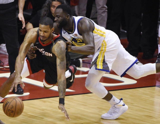 Houston Rockets forward Trevor Ariza, left, is fouled by Golden State Warriors forward Draymond Green during the final moments of Game 5 of the NBA basketball playoffs Western Conference finals, Thursday, May 24, 2018, in Houston. (AP Photo/Eric Christian Smith)