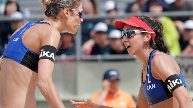 Beach volleyball world champions Sarah Pavan, left, and Melissa Humana-Paredes of Canada are getting back in the groove of competition ahead of the Tokyo Olympic tournament.  (Kiyoshi Ota/Getty Images/File - image credit)