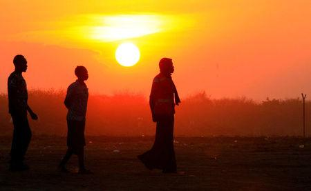 File Photo: People who fled fighting in South Sudan are seen walking at sunset on arrival at Bidi Bidi refugee resettlement camp near the border with South Sudan, in Yumbe district