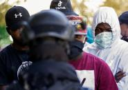 Haitian migrants urged by Mexican officials to leave border camp in Ciudad Acuna