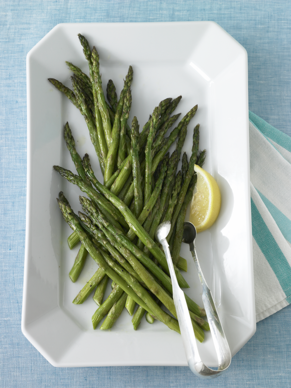 """<p>Don't stress about the sides! Just roast asparagus with olive oil and lemon and call it a day.</p><p><em><a href=""""https://www.womansday.com/food-recipes/food-drinks/recipes/a11261/roasted-asparagus-recipe-122903/"""" rel=""""nofollow noopener"""" target=""""_blank"""" data-ylk=""""slk:Get the recipe from Woman's Day »"""" class=""""link rapid-noclick-resp"""">Get the recipe from Woman's Day »</a></em></p>"""