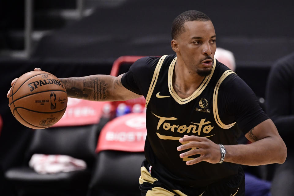 Norman Powell dribbles the ball during a game.