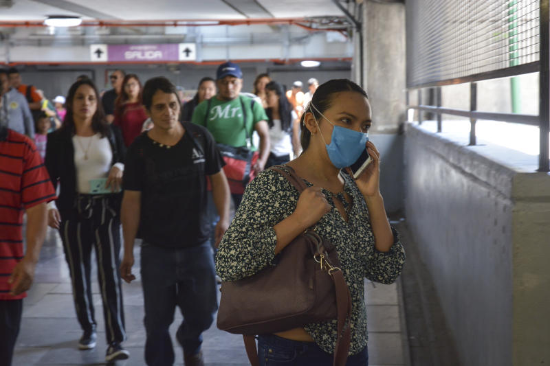 MEXICO CITY, MEXICO - MARCH 20: Woman wearing protective mask talks by cellphone on the Mexico City Metro on March 20, 2020 in Mexico City, Mexico. As the COVID-19 pandemic spreads, Mexico's Ministry of Health confirmed 203 positive cases and one deceased. (Photo by Medios y Media/Getty Images)