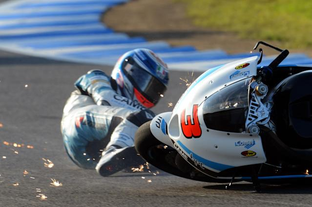 TOPSHOTS Moto2-class FTR rider Simone Corsi of Italy falls in the V-turn during the second free practice of the MotoGP Japanese Grand Prix at the Twin Ring Motegi circuit in Motegi on October 12, 2012. AFP PHOTO / TOSHIFUMI KITAMURATOSHIFUMI KITAMURA/AFP/GettyImages