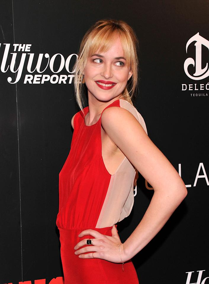 """NEW YORK, NY - DECEMBER 11:  Dakota Johnson attends a screening of """"Django Unchained"""" hosted by The Weinstein Company with The Hollywood Reporter, Samsung Galaxy and The Cinema Society at Ziegfeld Theater on December 11, 2012 in New York City.  (Photo by Stephen Lovekin/Getty Images)"""