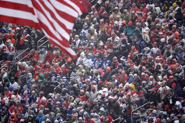 Hockey fans pack Michigan Stadium as they watch the first period of the Winter Classic outdoor NHL hockey game between the Detroit Red Wings and the Toronto Maple Leafs in Ann Arbor, Mich., Wednesday, Jan. 1, 2014. (AP Photo/Carlos Osorio)