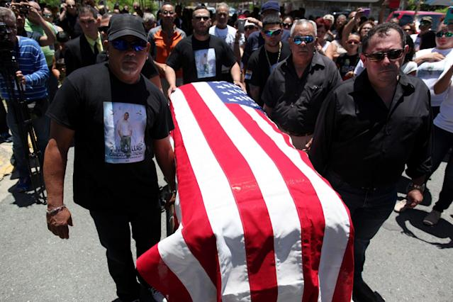 <p>Family and friends carry the coffin of Angel Candelario, one of the victims of the shooting at the Pulse night club in Orlando, covered with a American flag during his funeral at his hometown of Guanica, Puerto Rico, June 18, 2016. (Reuters/Alvin Baez) </p>