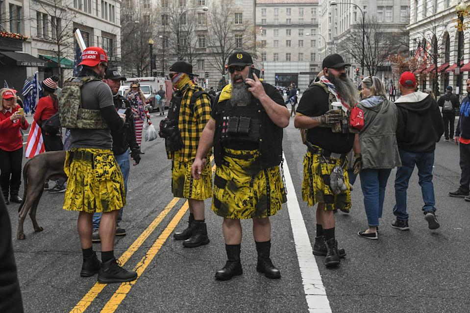 WASHINGTON, DC - DECEMBER 12: Members of the Proud Boys, wearing kilts, gather outside of Harry's bar during a protest on December 12, 2020 in Washington, DC. Thousands of protesters who refuse to accept that President-elect Joe Biden won the election are rallying ahead of the electoral college vote to make Trump's 306-to-232 loss official. (Photo by Stephanie Keith/Getty Images)