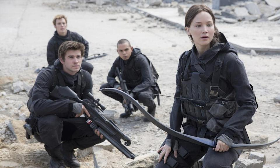 Liam Hemsworth, Sam Clafin, Evan Ross and Jennifer Lawrence in The Hunger Games: Mockingjay, Part 2.