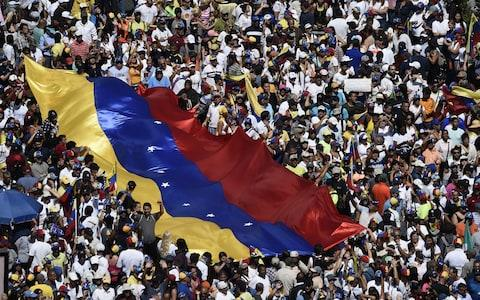 <span>Opposition activists pour onto the streets on Saturday, to back Venezuelan opposition leader Juan Guaido's calls for early elections</span>