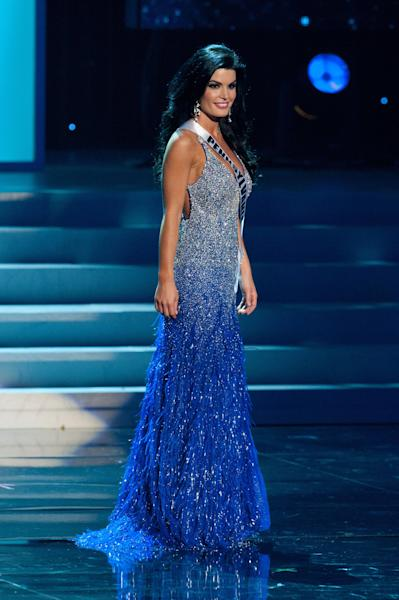 FILE - In this May 30, 2012 file photo provided by the Miss Universe Organization, Miss Pennsylvania Sheena Monnin competes during the 2012 Miss USA Presentation Show in Las Vegas. A federal judge in New York has upheld an arbitrator's ruling that Monnin must pay the Miss USA pageant $5 million for defaming Donald Trump's pageant organization. She resigned as Miss Pennsylvania last year, saying the contest was rigged and claimed another contestant learned the names of the top five Miss USA finishers hours before the show was broadcast. (AP Photo/Miss Universe Organization, Darren Decker, File)