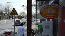 China colour-codes buildings and businesses to push Covid-19 vaccination