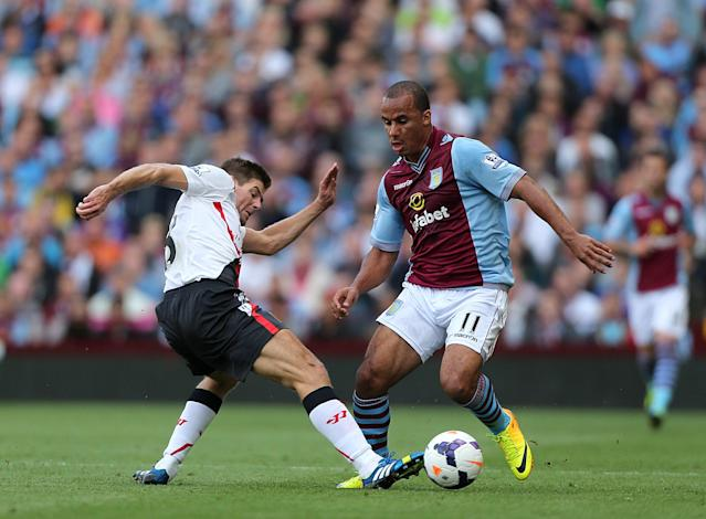 Liverpool's Steven Gerrard (left) and Aston Villa's Gabriel Agbonlahor (right) battle for the ball
