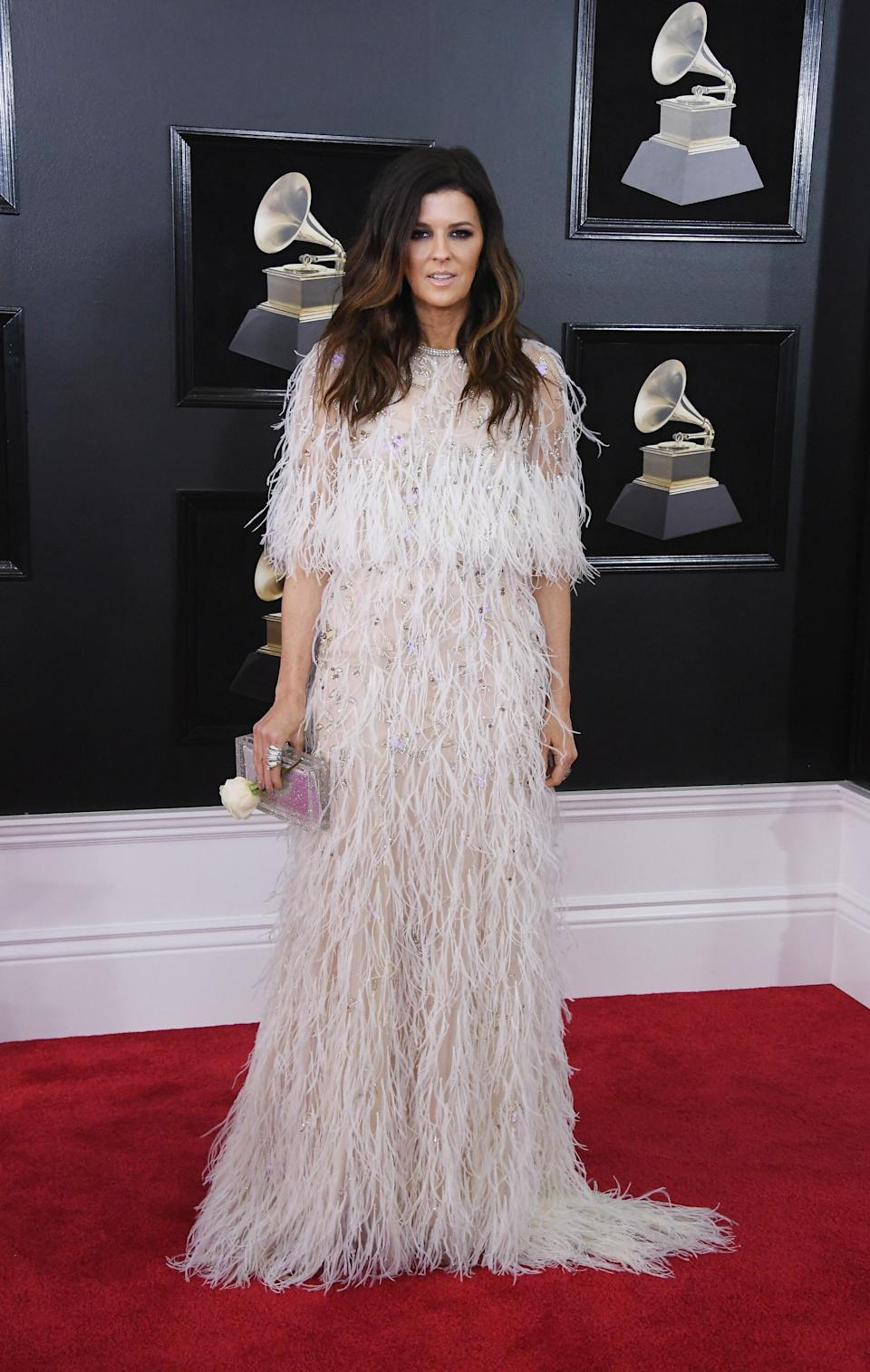 """<h1 class=""""title"""">Karen Fairchild with a Judith Leiber Couture bag</h1><cite class=""""credit"""">Photo: Getty Images</cite>"""